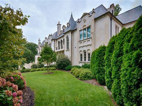 style home in limestone mediterranean exterior