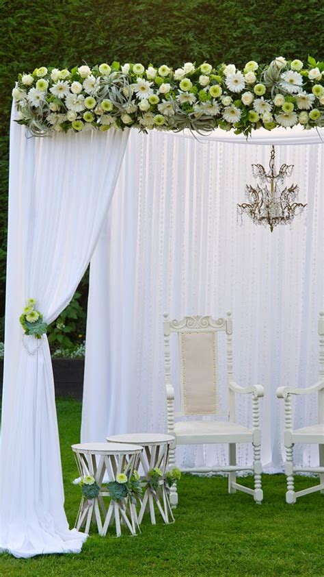 white wedding drapes outdoor wedding venue in epping essex gaynes park
