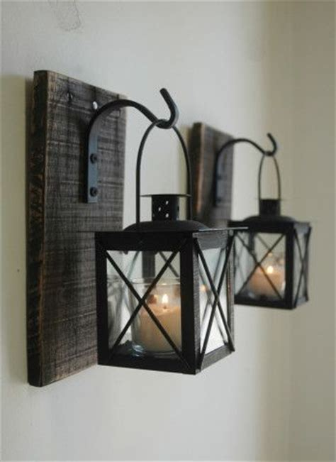 iron home decor lantern pair with wrought iron hooks on recycled wood