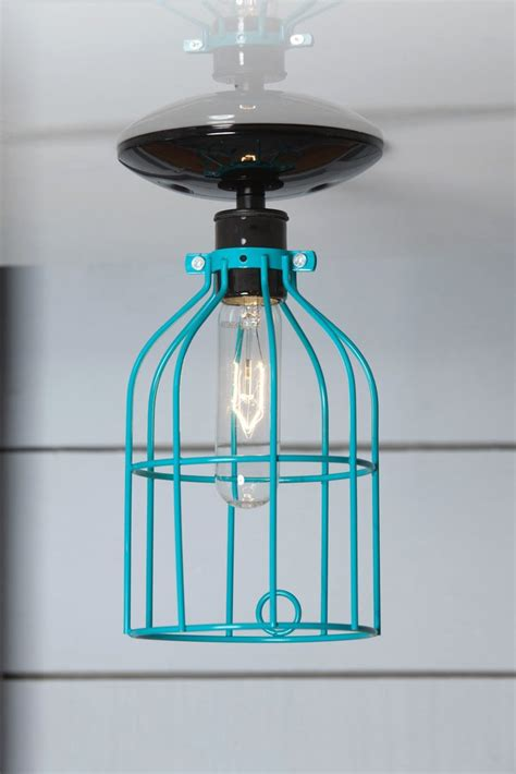 industrial lighting turquoise blue cage light ceiling