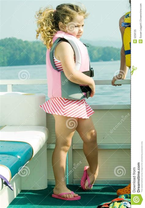 girl on front of boat girl on front of boat profile royalty free stock photo