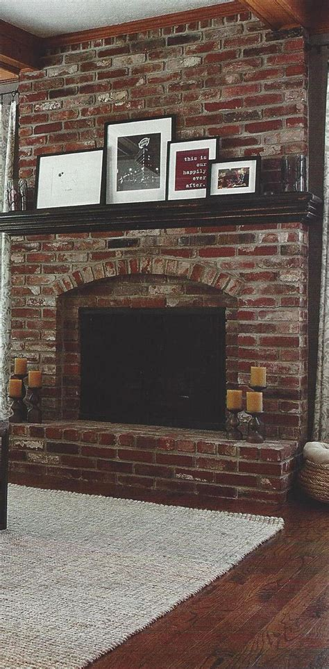 red brick fireplace  dark wood mantel