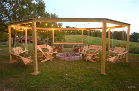 fire pit surrounded by swings remodelaholic tutorial build an amazing diy pergola and