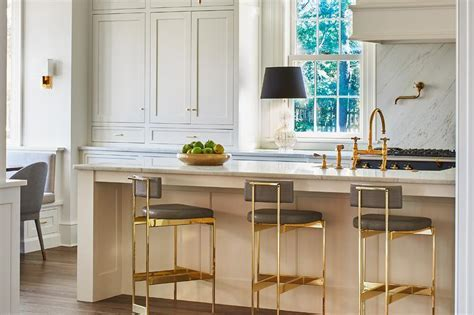 Cream and Gray Kitchen with gold and Gray Bar Stools