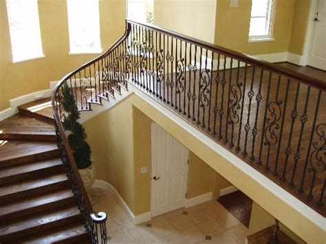 Refinishing Stair Banister by Chicago Property Electrostatic Painting Chicago