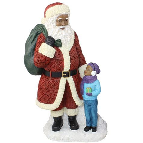 african american santa claus standing with boy the black