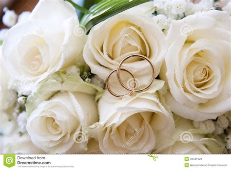 Ee  Wedding Ee   Rings On A Bouquet Of Roses Photo Image