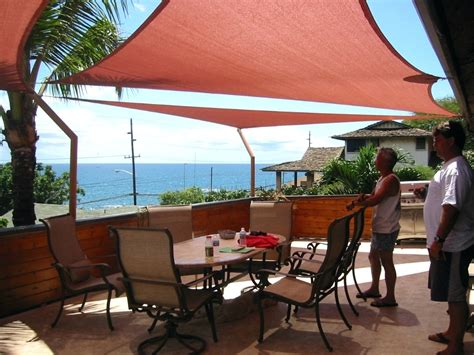image of sun shade sail residential patio sun shade patios shade structure and sun sail shades a fabric patio cover provides shade from the sun objectif 2017
