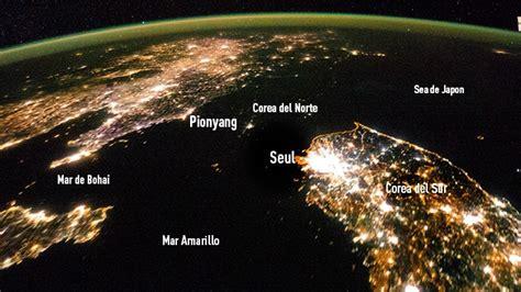 imagenes satelitales nocturnas de la tierra video a corea del norte se lo traga la noche en las