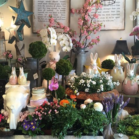 whats  store topiaire floral boutique sings spring