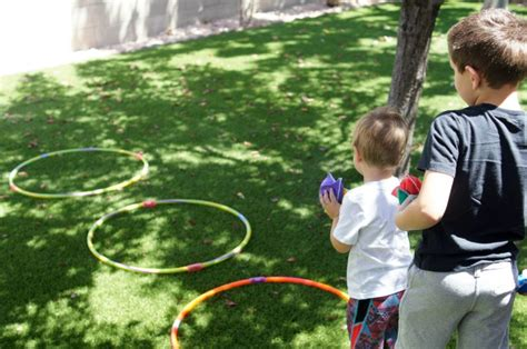 throwing beanbags into hoops creative ways to play with hula hoops not quite susie