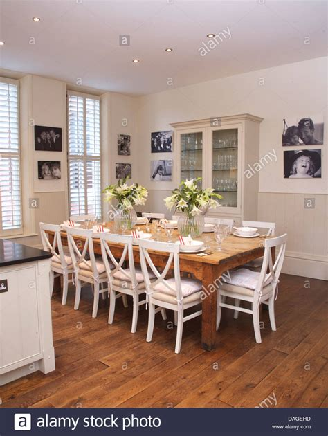 White And Wood Kitchen Table by White Chairs At Simple Wood Table In Modern White Kitchen