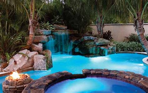 backyard lagoon swimming pool with natural stone grotto waterfall by lucas
