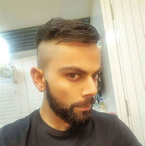 new hairstyle of virat kohli virat kohli flaunts new hairstyle ahead of new zealand
