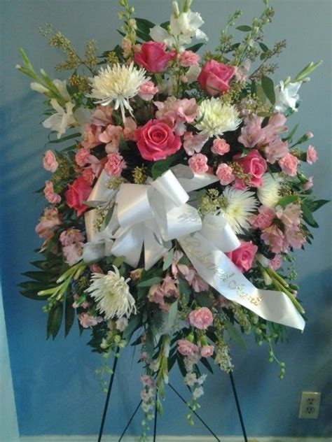mum flower arrangement pink jpeg this pink and white standing spray is made with roses fuji spider mums gladiolus mini