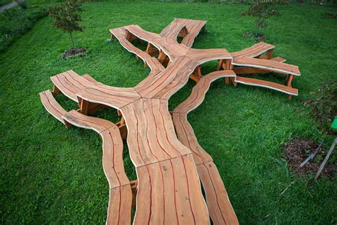 branching looping wooden tables by michael beitz colossal