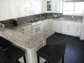 bianco antico granite on white cabinets contemporary