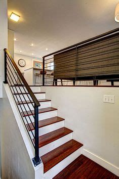 treppengeländer rund contemporary staircase with wall sconce hardwood floors
