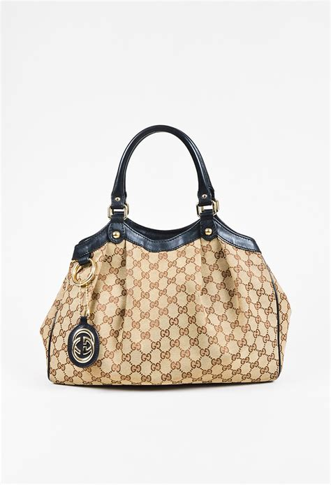gucci brown beige canvas gg monogram black leather trim