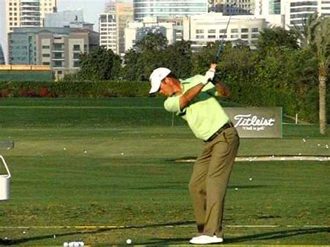 left swing richard green slow motion dubai driving range down the