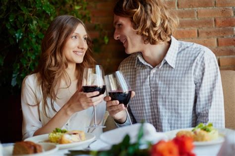 romantic couple drinking wine romantic couple drinking wine in a restaurant photo free
