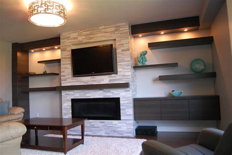 tv mounted on fireplace wall mounted fireplace and floating cabinet and shelves