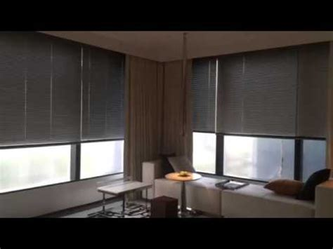 Blind Hotels motorised curtains with venetian blinds in hotel room
