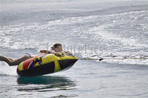 inner tube pulled by boat fun on inner tube stock picture i2467777 at featurepics