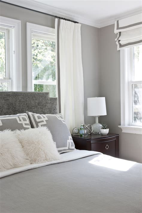 grey and white bedroom curtains headboard in front of window design ideas