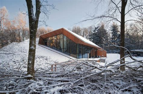 Cabin Home On The Hill by Modern Cabin Camouflaged By An Artificial Hill