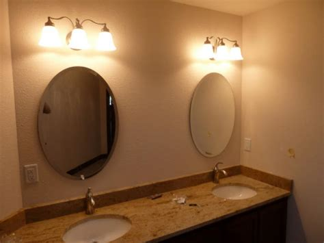 how to frame an oval bathroom mirror bathroom bring a touch of calm elegance to your bathroom