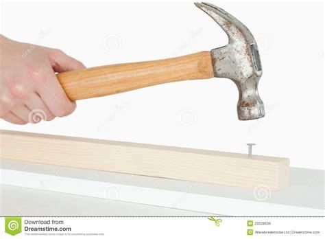 Bor Hammer hammer driving a nail into a wooden board royalty free