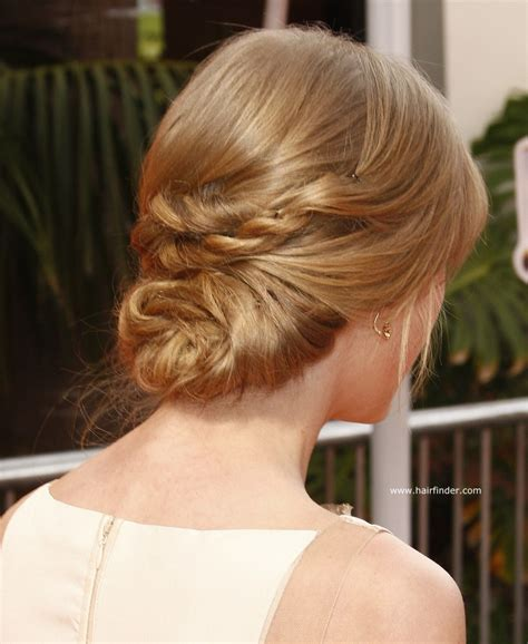 by hairstyle taylor swift hair in a low updo for formal occasions