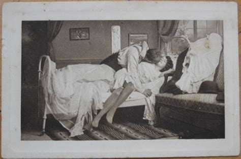 women kissing in bed 1915 postcard man kissing a woman in stockings in bed ebay
