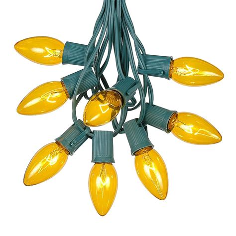 yellow c9 outdoor string light set on green wire novelty