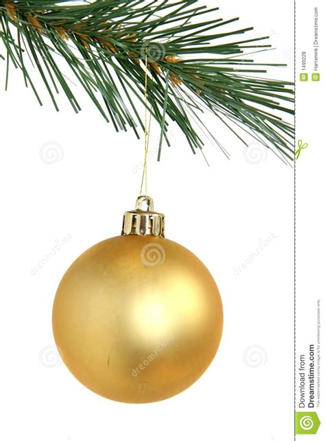 golden christmas ball hanging from christmas tree stock