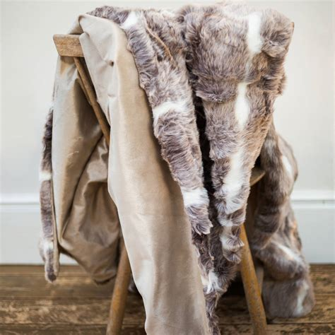 how to put a fur throw on a sofa large faux fur mink throw cushion set by the nordic room
