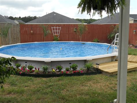 above ground pools prices small backyard landscaping ideas i m not a big fan of having a pool because of the costs
