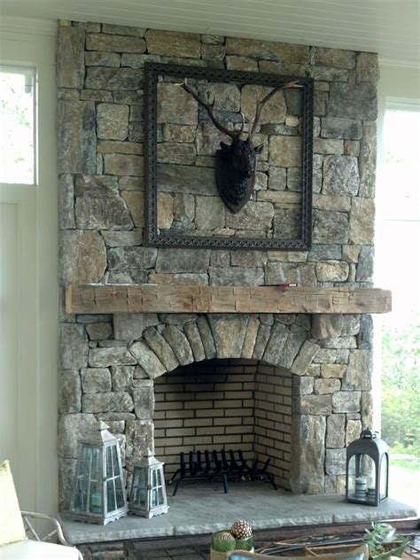 Native stone fireplace with arch stone detail sample 03