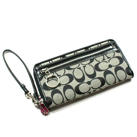 The Signature Chateau Wristlet Clutch by Coach Signature Large Zip Around Wallet Clutch
