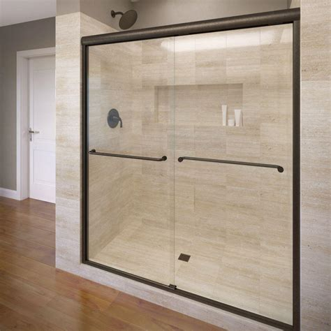 Bronze Shower Doors Frameless Basco Celesta 48 In X 71 1 4 In Semi Frameless Sliding Shower Door In Rubbed Bronze With