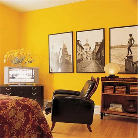yellow walls in bedroom bedroom with yellow walls and wall photos decorating a