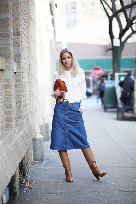 a denim midi skirt and knee high boots are transitional
