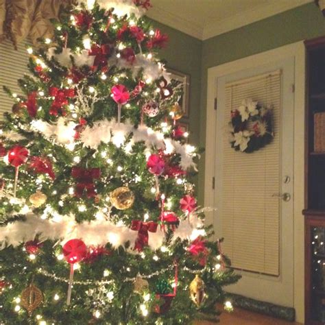 red and white christmas tree with feather boa gorgeous