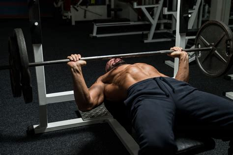 lower back pain bench press watchfit the bench press arch is it safe to arch your back