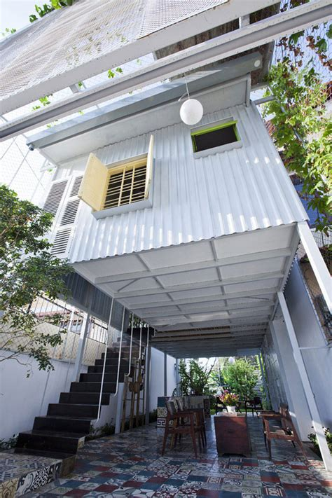 industrial steel stilt home with open primary level