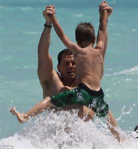 mark wahlberg and his family cool off in the ocean following easter