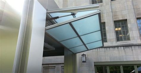 The Hydraulic Lift System Operates The Large Doors Doors Overhead Bifold Doors