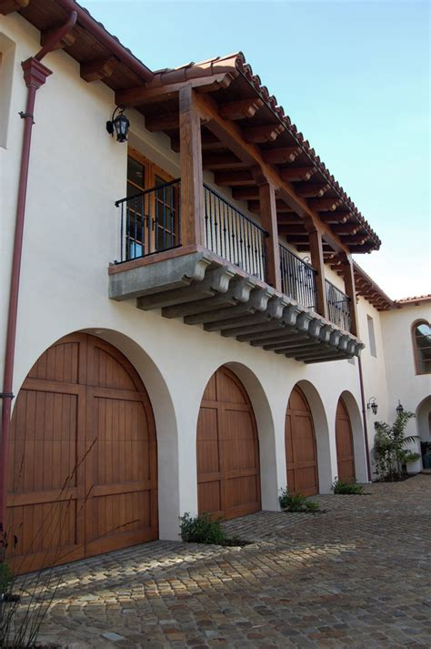 arched garage doors Garage And Shed Mediterranean with