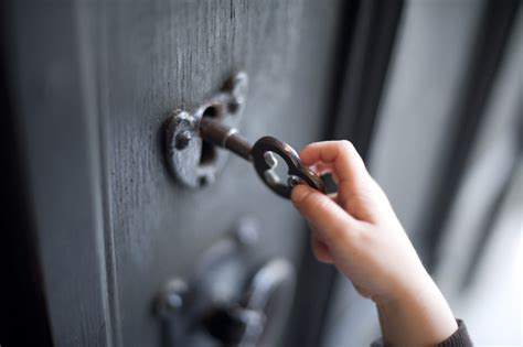 How To Get In A Locked Door by Boy Unlocking A Door 7249 Stockarch Free Stock Photos